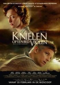 knielen_op_een_bed_violen