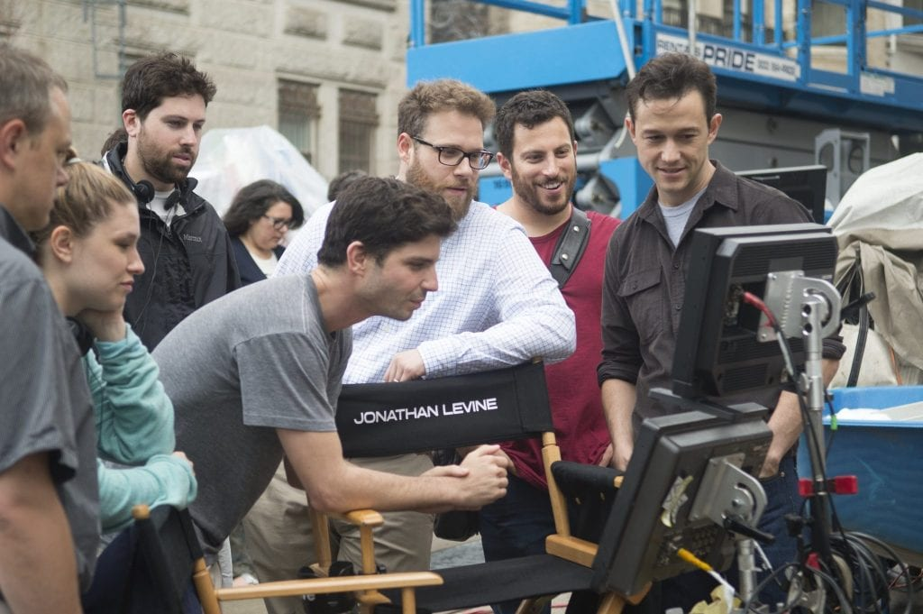 """L-r, Direcotr Jonathan Levine, Seth Rogen and Joseph Gordon-Levitt on the set of Columbia Pictures' """"The Night Before,"""" also starring Anthony Mackie."""