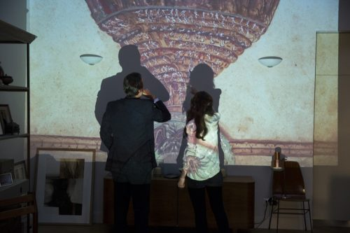 Langdon (Tom Hanks) and Sienna (Felicity Jones) study the Map Of Hell and notice it has been altered in Columbia Pictures' INFERNO.